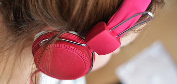 Woman listening to podcast